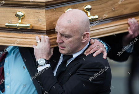 Keith Wood carries The coffin of Munster Rugby head coach Anthony Foley