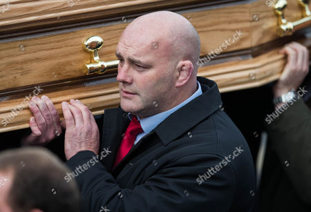 John Hayes carries The coffin of Munster Rugby head coach Anthony Foley