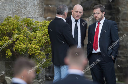 Former Munster and Ireland players Keith Wood and Marcus Horan arrive for the funeral of Munster Rugby head coach Anthony Foley