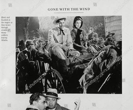 "Quot;GONE WITH THE WIND&quot Clark Gable and Vivien Leigh star as Rhett Butler and Scarlett O'Hara in the 1939 cinematic classic ""Gone with the wind."" In the hearts and minds of moviegoers everywhere, a Civil War saga made 53 years ago remains the most beloved film"