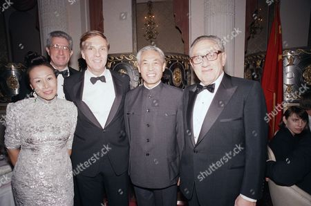 Stock Image of Henry Kissinger, Bette Bao Lord, Winston Lord, Han Xu, Richard Solomon Mrs. Bette Bao Lord; her husband, Winston Lord U.S. ambassador to China; China's Ambassador to the U.S. Han Xu; and Dr. Henry Kissinger; and background, left, wearing glasses, Richard Solomon, Assistant Secretary of State for Policy Planning. The group posed at the Park-Plaza in New York City, at a dinner marking the 10th anniversary of normalization of U.S.-Chinese relations