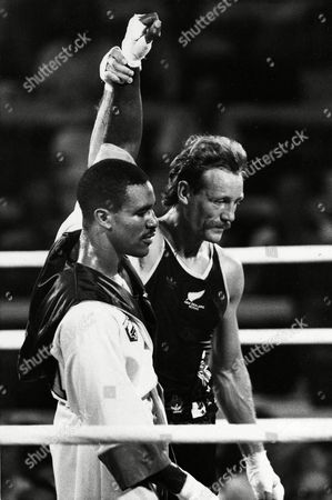 "Evander Holyfield, Kevin Barry New Zealand's Kevin Barry, right, raises the hand of Evander Holyfield after the 178-pound class American boxer was disqualified from the Olympic semifinals for knocking Barry down after referee Gligorije Novicic had called ""stop,"" in Los Angeles, Calif"