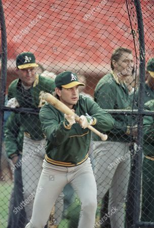 Oakland Athletics' Bob Welch, who is scheduled to start in game three of the World series, works on his batting in San Francisco, as teammates including Mike Moore (right) watch. Welch spent most of his career in the National League and will be batting tomorrow when the Series shifts to Candlestick Park
