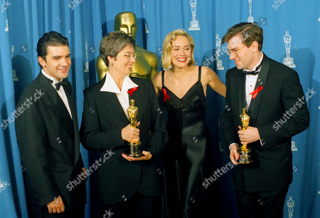 """Antonio Banderas, left, and actress Sharon Stone, second from right, present Oscars to Gloria S. Borders and Gary Rydstrom for sound effects editing for the """"Terminator 2: Judgement Day"""" at the 64th Annual Academy Awards in Los Angeles"""