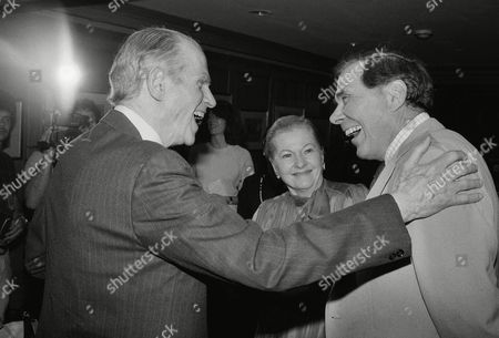 """Actress Joan Fontaine, center, shares a laugh with Alger Hiss, left, and TV game show host Gene Rayburn at the reception to celebrate Boston University's """"20h Century Archivers,"""" in New York. The archivers are the only in America to feature the personal memorabilia of nearly 1,500 authors, film makers, politicians, and other major public figures of the 20th century"""