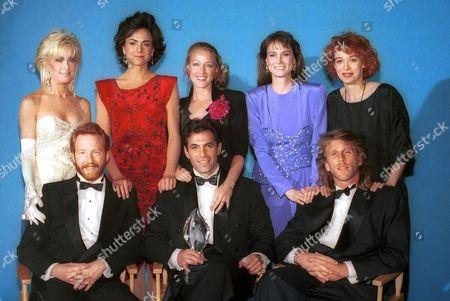 "30 SOMETHING TV This is the cast portrait for the television show ""30 Something"" at the People's Choice Awards on . Front row from left: Timothy Busfield, Ken Olin, and David Clennon. Second from from right: Melanie Mayron, Mel Harris, Patricia Wettig, Polly Draper, and unidentified blond actress"