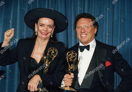 """Executive producer Dan Curtis, right, joins producer Barbara Steele backstage at the 41st Annual Emmy Awards night on in Pasadena, Calif. after their miniseries. """"War and Remembrance"""" grabbed the Emmy for outstanding miniseries. """"A major shock."""" exclaimed Curtis"""