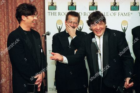 "Members of ""The Band"" Rick Danko, right, and Robbie Robertson, left, and guitarist Eric Clapton share a light moment backstage after the Ninth Annual Rock and Roll Hall of Fame Induction Ceremony in New York is Waldorf Astoria Hotel"