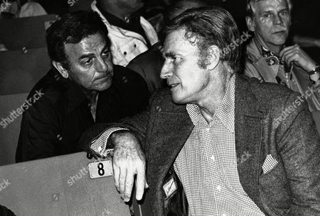 Charlton Heston, Mike Connors Actor Charlton Heston, right, and actor Mike Connors confer in Los Angeles during a meting of the screen Actor's Guild on . The actor's guild is debating a proposed merger between the Screen Actor's Guild and the Screen Extras Guild, which some members of the actor's guild oppose