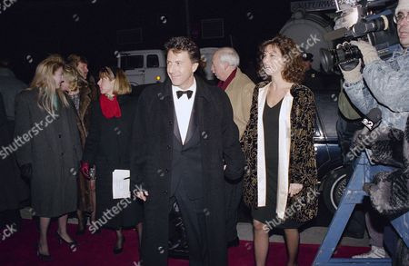 "Dustin Hoffman, Lisa Hoffman Actor Dustin Hoffman, left, escorts his wife, Lisa, into the Loew's Astor Plaza theater for the world premiere of his new movie, ""Rain Man"" in New York on . The film stars both Hoffman and actor Tom Cruise, who was unable to attend the premiere"