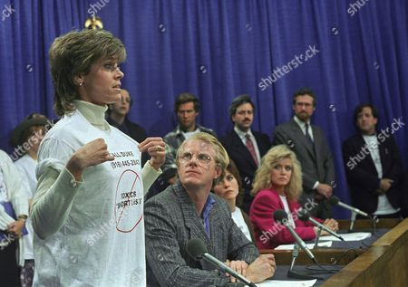 Actress Jane Fonda and other Hollywood notables critical of California Gov. Deukmejian for his implementation of Prop. 65, the anti-toxic initiative that was approved by voters last November, talk to reporters during a news conference at the Capitol in Sacramento, after the governor refused to meet with them to discuss their concern. Also in the news conference are Ed Begley, foreground right, Jeff Bridges, rear right, Vincent Schiavelli, rear center, and Rosanna Arquette, rear left