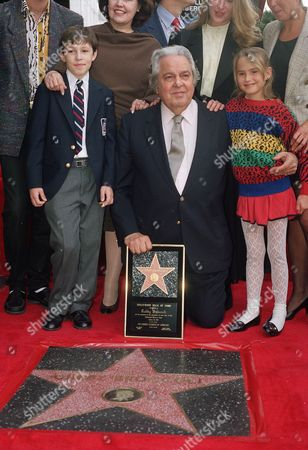 "Producer Albert R. ""Cubby"" Broccoli is joined by his grandson, Greg Wilson and granddaughter, Heather Banta, as he receives a star on the Hollywood Walk of Fame . The tribute was paid to Broccoli for the many James Bond films he has produced over the past 28 years"
