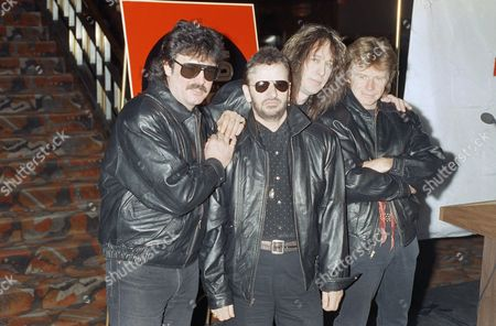 Ringo Starr, second from left, poses at New York?s Radio City Music Hall with members of his All-Starr Band for a news conference for their World Tour '92, . From left to right, Burton Cummings, Starr, Todd Rundgren and Dave Edmunds, will perform with other artists not show. The tour will take them to Europe and North America
