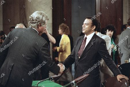 Atlanta Mayor Andrew Young, right, is greeted by Sen. Edward Kennedy, D-Mass., during a break in Monday's confirmation hearings for Supreme Court nominee Robert H. Bork before the Senate Judiciary Committee on Capitol Hill, in Washington. Young testified against Bork?s confirmation