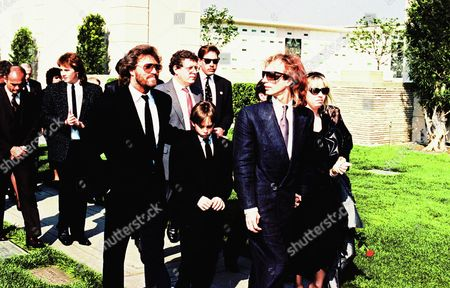 Barry Gibb, left, and Robyn Gibb, right, leave memorial service for their brother, pop star Andy Gibb, on Monday afternoon, at Forest Lawn in the Hollywood Hills. Gibb died March 10 in London, England