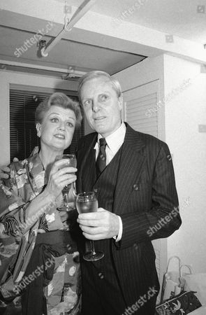 """Angela Lansbury, John McMartin Angela Lansbury and John McMartin toast their opening performance of """"A little family business"""" backstage at New York's Martin Beck Theatre in New York"""