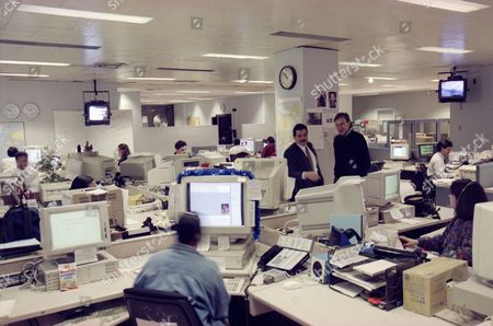 Alabiso Hart This is a general view of the photo department at the Associated Press in New York, seen . Standing at center are executive photo editor Vin Alabiso, left, and photo editor Steve Hart
