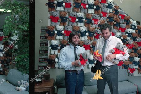 Stock Photo of WOZNIAK BUSHNELL Steve Wozniak, creator of Apple's first computer, left, and Nolan Bushnell, founder of Atari Inc., play with stuffed toys at Bushnell's AXLON Inc. offices in Sunnyvale, Calif., on . Wozniak and Bushnell, pioneers of the personal computer and video game, have joined forces to build electronic children's toys