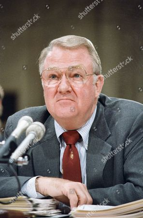 "Attorney General Edwin Meese III appears before the congressional committee investigating the Iran-Contra affair on Capitol Hill in Washington on . Testifying under oath and without is at the nationally televised hearings, Meese said ""my own counsel"" was to support the secret sale of to Iran when his opinion was asked in January 1986"