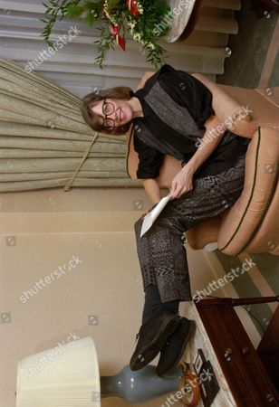 """Stock Image of JANE SMILEY Author Jane Smiley relaxes in her New York hotel room in November 1991 while in town to promote her new novel """"A Thousand Acres"""". The book tells the King Lear-like story of an Iowa farmer who turns over his land to his three daughters and soon descends into madness, accusing the two elder children of stealing the property"""