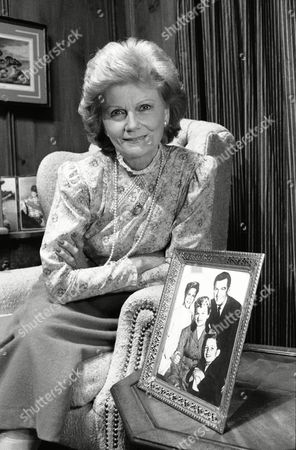 Actress Barbara Billingsley sits next to a portrait of her television family of old, Hugh Beaumont, Tony Dow, Jerry Mathers and herself ? as the Cleaver family - during a interview, . Ms. Billingsley will once again resume the role as June Cleaver when she appears in the upcoming Turner Broadcasting Co. series, ?Still the Beaver
