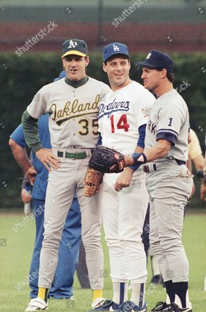 Oakland A's Bob Welch, left, Los Angeles Dodger's Mike Scioscia, center, and New York Yankees' Steve Sax, all former Doger teammates, enjoy a moment together on before the start of the 61st annual All Star game in Chicago