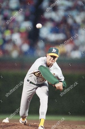 Starting pitcher Bob Welch, of the Oakland A's, fires a pitch home during the first inning of the All Star Game at Wrigley Field in Chicago on night