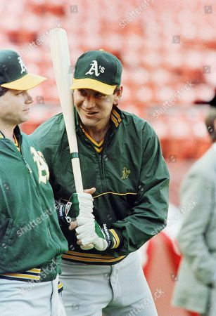 Oakland Athletics pitcher Bob Welch (right), scheduled to start in Game 3 of the World Series, chats with fellow pitcher Rick Honeycutt prior to taking batting practice on Monday afternoon, in San Francisco. Pitchers will bat on Tuesday when the series moves to Candlestick Park
