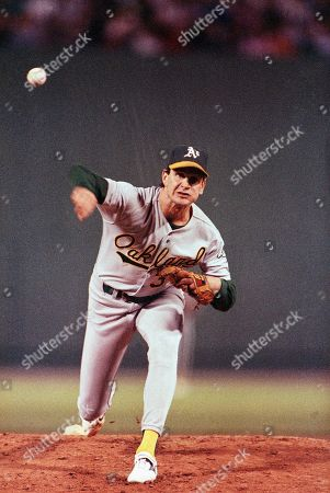 Stock Picture of Oakland Athletics pitcher Bob Welch pitches against the Boston Red Sox in the first inning of game two of the American League Championship Series, on at Fenway Park in Boston