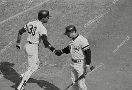 Stock Photo of New York Yankees runner Willie Randolph, left, is greeted at home by teammate Reggie Jackson after scoring in the first inning of the World Series, Los Angeles, Calif. Randolph scored from third on a single by Yankees batter Larry Milbourne