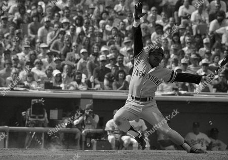 New York Yankees batter Reggie Jackson twists as he misses a pitch from Los Angeles Dodgers pitcher Bob Welch in the first inning of the World Series, Los Angeles, Calif. Jackson, starting his first game in the 1981 Series, singled in the inning