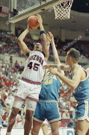 Arizona Wildcats Sean Rooks goes up and over UCLA's Don MacLean score two points during their championship game in the PA-10 tournament Watching the play is UCLA (30) Tracy Murray Arizona led 46-32 at the half on in Tempe