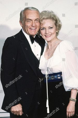 Betty White, Ted Knight Shown in photo is Actress Betty White with Ted Knight at the Emmy Awards in Los Angeles on