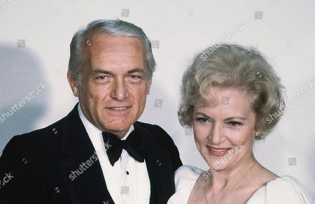 Betty White, Ted Knight Actress Betty White with Ted Knight at the Emmy Awards in Los Angeles