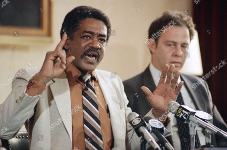Former Black Panther Party chairman Bobby Seale, (left), gestures during a press conference on in San Francisco, where he urged support for a letter-writing campaign aimed at getting the Calif. state parole board to free imprisoned Elmer ?Geronimo? Pratt. Seated at right is Pratt?s attorney Stuart Hanlon