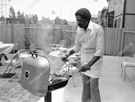 Bobby Seale, the radical, the former chairman of the Black Panther Party, the firebrand of the 1960s, checks out a recipe for his cookbook in the backyard of his home in Aurora, Colo., on