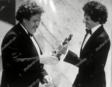 """British actor and writer Colin Welland, left, accepts an Oscar for the best screenplay from Jerzy Kosinski, during the 54th annual Academy Awards presentation, Los Angeles. Actor and writer Colin Welland, who famously told Hollywood """"the British are coming"""" when he won an Academy Award for """"Chariots of Fire,"""" has died aged 81. His family said in a statement that Welland, who had suffered from Alzheimer's disease, died peacefully in his sleep late Monday"""