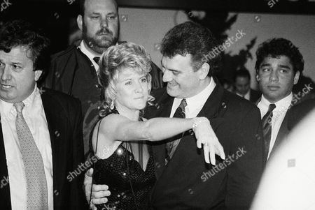 """Mary Jo Buttafuoco, left, shows off the one carat diamond and emerald ring inscribed with the words, """"I love you forever, Joey"""", given to her by husband Joey Buttafuoco, right, during a party, in Syosset, N.Y., in honor of Buttafuoco's release from Nassau County Jail Wednesday. The 38-year-old Buttafuoco spent 129 days in prison for statutory rape of his lover Amy Fisher"""