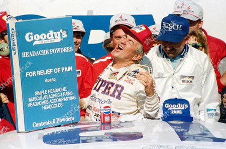 Bobby Allison, from Hueytown, Ala., center, gives a yell in victory lane after winning the Goody's 300 Auto race at Daytona International Speedway in Daytona Beach, Fla