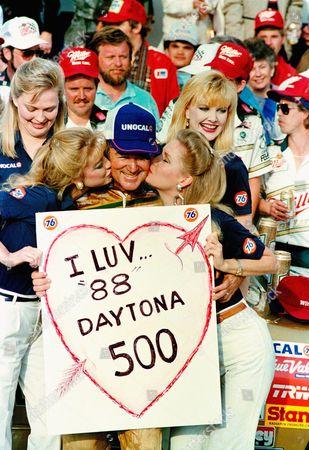 Bobby Allison, from Hueytown, Ala., gets victory's reward after winning the Daytona 500 auto race in Daytona Beach, Fla