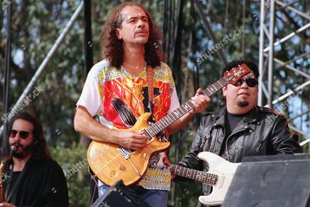 Santana Rock guitarist Carlos Santana, center, performs with Cesar Rosas, guitarist with rock group Lobo Los, during a tribute concert to legendary rock promoter Bill Graham at San Francisco's Golden Gate Park, Ca., . Graham and two others died in a helicopter accident last week