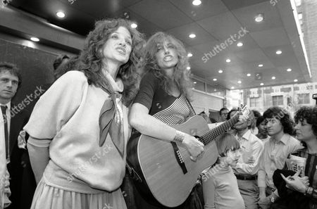 Carly Simon, Lucy Simon Carly, right, and Lucy Simon serenade the crowd gathered in Broadway's Shubert Alley in New York, in support of nuclear disarmament. The impromptu concert, sponsored by Performing Artists for Nuclear Disarmament, was a warm-up for the mass rally and concert in New York's Central Park