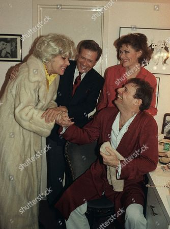 """Carol Channing, left, and Jerry Herman, second from left, stop backstage to visit with stars Jessica Walter and Ron Leibman following their performance of """"Rumors"""" at the Broadhurst Theater in New York, . Walter and Leibman, who appear as husband and wife characters in the play, are also married in real life"""