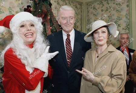 Carrol Channing, James Stewart, Loretta Young Carol Channing, dressed in Santa Claus outfit, James Stewart and Loretta Young share a smile before the 47th annual Golden Apple Award luncheon in Beverly Hills, California, . Stewart presented Miss Young with the Louella O. Parsons Award