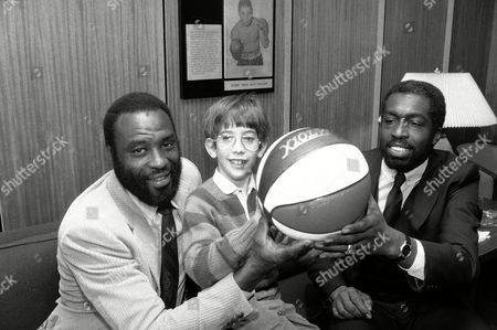 """Stock Photo of Cazzie Russell Former New York Knicks Cazzie Russell, left, and Earl """"The Pearl"""" Monroe, right, join 8-year-old Scott Nussbaum at the Hall of Fame Room at Madison Square Garden in New York"""