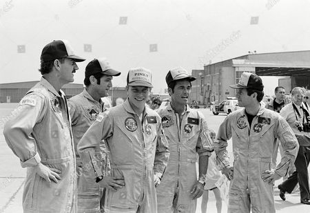 Stock Image of Van Hoften Scobee Nelson Crippen The shuttle Challenger crew appear after returning from a six-day mission. In their nickname caps, left to right, are: James van Hoften (Ox), Francis Scobee (Dick), George Nelson (Pinky), Robert Crippen (Crip), and Terry Hart (T.J