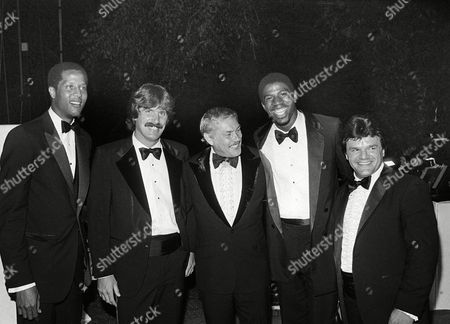 Jerry Buss, Jamaal Wilkes, Charlie Simmer, Earvin Johnson, Magic Johnson, Marcel Dionne Dr. Jerry Buss stands with members of his teams' during a charity dinner at his Pickfair mansion in Beverly Hills, Calif., . From left: Los Angeles Lakers Jamaal Wilkes, Los Angeles Kings Charlie Simmer, Buss, Lakers Magic Johnson, and Kings Marcel Dionne