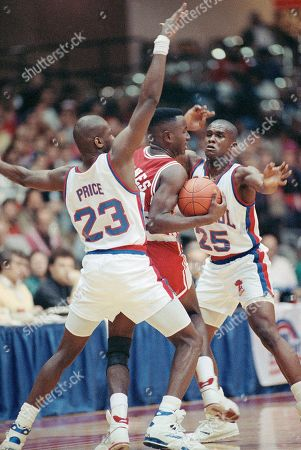 Stock Picture of Charles Barnes Illinois State's Charles Barnes, center, is surrounded by DePaul's Curtis Price, left, and Terry Davis, right, during first-half action in the First Chicago Christmas Classic in Rosemont, Illinois on