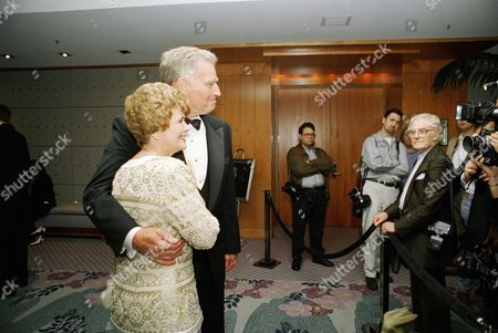 Charlton Heston, Lydia Clarke Heston Hollywood legend Charlton Heston and his wife Lydia Clarke Heston pose for some paparazzi photographers during their fiftieth wedding anniversary at the Hotel Nikko in Los Angeles on