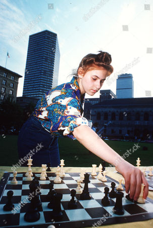 Stock Picture of Chess Grandmaster Judit Polgar, 17, of Hungary, competes against a challenger on at the Boston International Chess Exhibition in Boston, Massachusetts, USA. U.S. Chess Champion Patrick Wolff, Polgar, and other grandmasters participated in the competition, taking turns moving from board to board to face over a hundred challengers